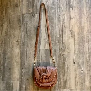 Tan crossbody bag with gold accents